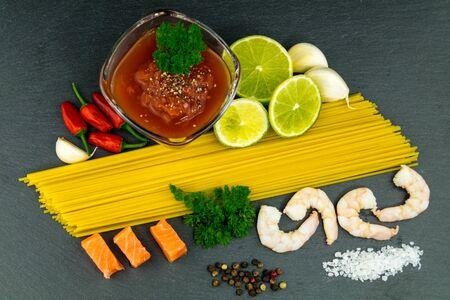 Spaghetti al Salmon - Noodles with Shrimps on salmon fillet 写真素材