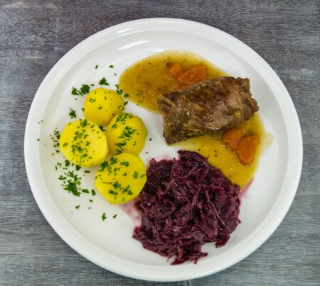 Traditional german food beef roulade with red cabbage
