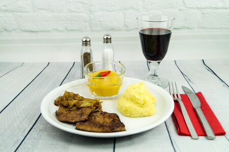 Fresh cattle liver with roasted onions and mashed potatoes