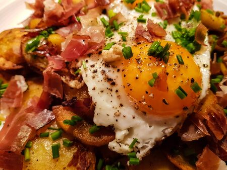 Farmers Breakfast with ham eggs and potatoes Stock Photo