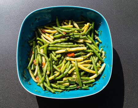 Fresh green beans with tomato and parsley