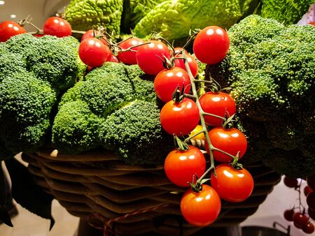 Broccoli and cherry tomatoes on a farmers market