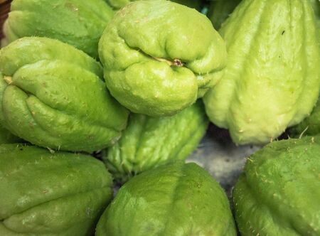 Chayote fruits on a farmers market