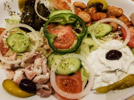 Greek salad with feta cheese olives and hot peppers