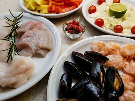 Ingredients for a portuguese seafood cataplana