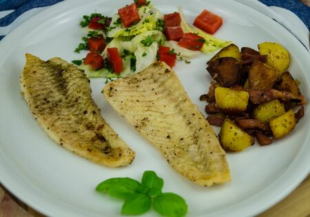 Flounder or plaice filet with herbs and spices Banque d'images