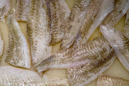 Flounder or plaice filet with herbs and spices Stock Photo
