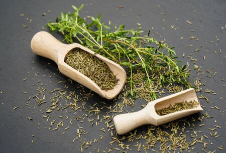 Thyme Thymus vulgaris and a wooden spoon