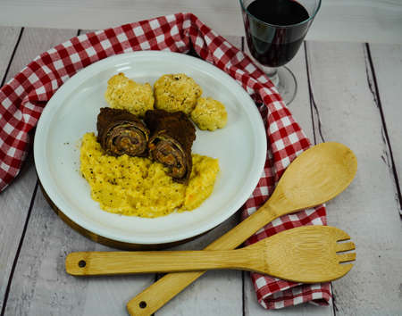 Traditional filled german beef roulade with celery puree and cauliflower Stockfoto