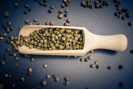 many green peppercorns on a table