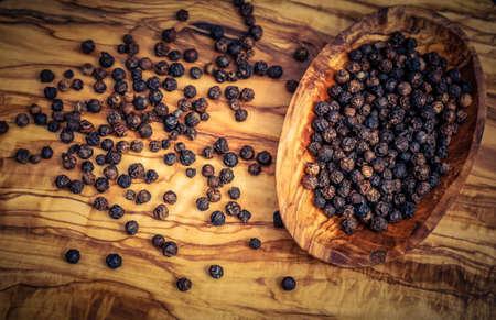 many black peppercorns on a table 写真素材