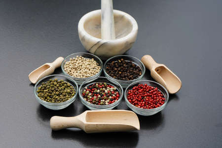 many peppercorns in different colors
