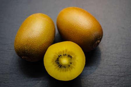 sliced golden kiwi fruit 写真素材