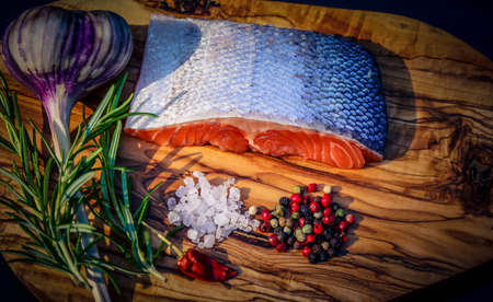 Fresh salmon trout fillet with herbs spices and salad for bbq