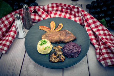 Baked Duck with red cabbage and forest mushrooms Archivio Fotografico