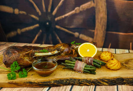 Roasted goose with beans and duchess potatoes Archivio Fotografico