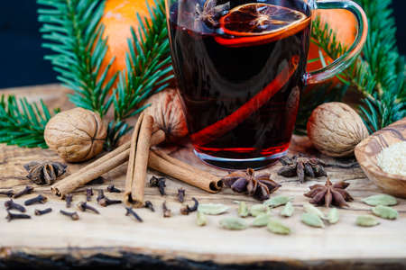 mulled wine and christmas spices on olive wood