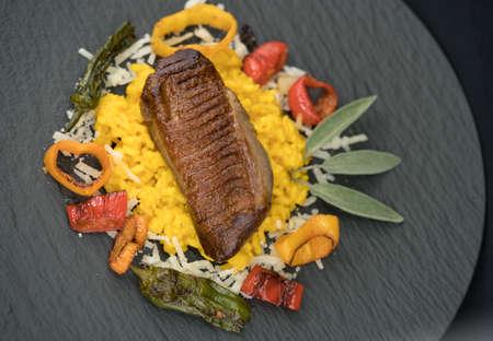 fried duck with saffron risotto Banque d'images