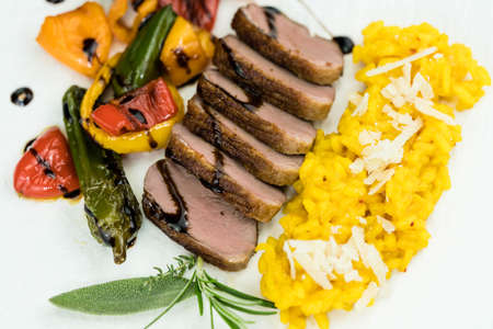 fried duck with saffron risotto