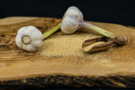 Garlic granules on olive wood