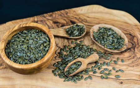 roasted pumpkin seeds on olive wood