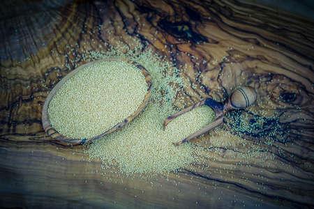 amaranth seed on olive wood Stock Photo