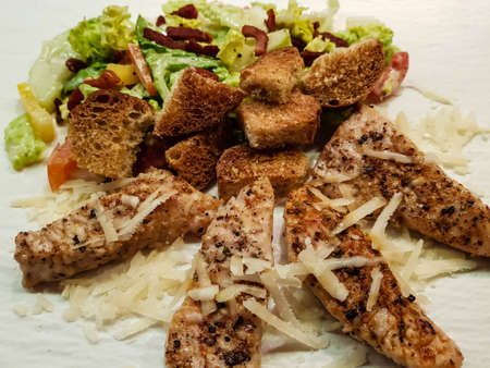 traditional caesars salad with grilled chicken Bacon Stripes and salted garlic bread