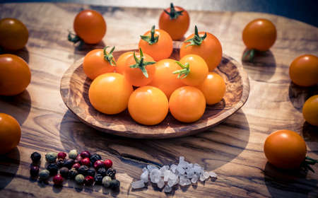 orange cocktail Tomatoes Solanum Lycopersicum on olive wood Imagens