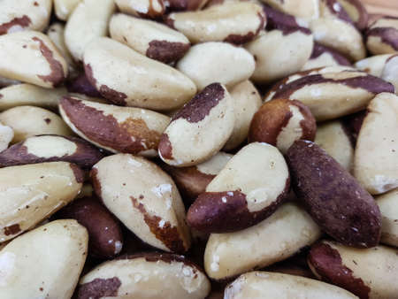 Brazil nuts on olive wood Imagens