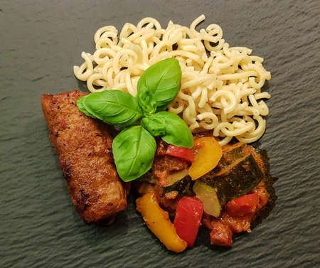 Veal roulade with Mediterranean vegetables in tomato sauce