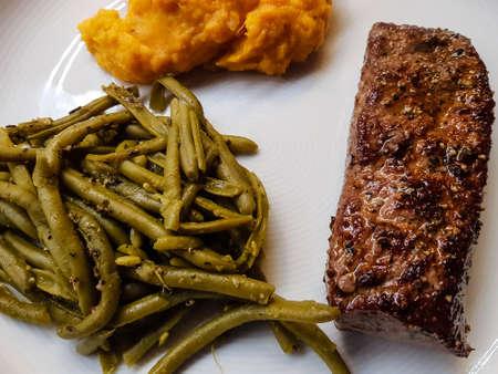 Rosemary lamb steaks with garlic