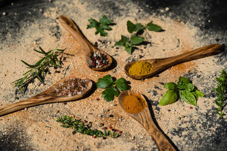 various herbs abd spices on olive wood 免版税图像
