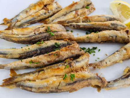 fresh fried sardines with herbs and spices