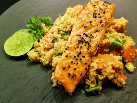 Norwegian fjord salmon with black sesame seeds on couscous