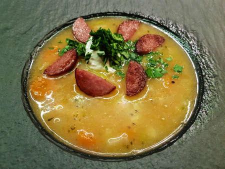 Potato soup with italian cabanossi sausages 免版税图像