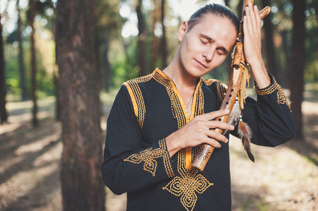 busker: ethnic music, ethnic musician, musician, meditation, wooden musical instruments, the guy playing the ethnic musical instruments Stock Photo