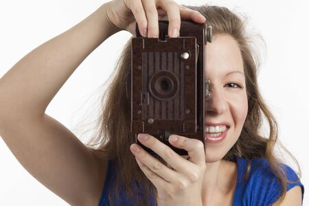 Photographing smiling Woman with old camera