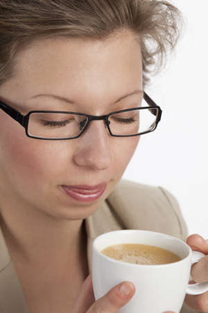 liberating: Young business woman relaxing at a coffee break