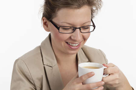 liberating: Smiling business woman enjoying a cup of coffee