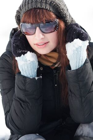 Young woman in a winter landscape photo