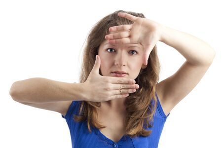 cropping: Young woman looking through her ​​hands