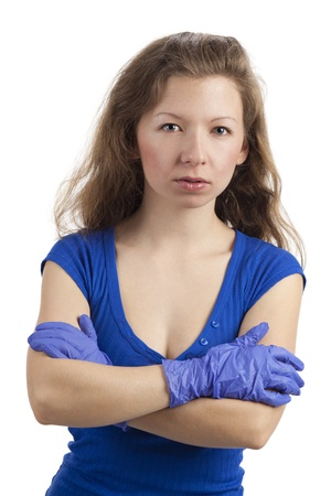 Serious-looking woman with blue-gloved arms crossed Stock Photo - 15891982