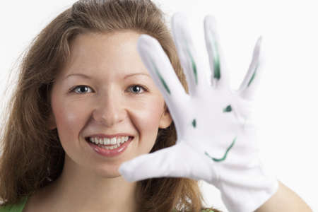 glove puppet: Young woman with crazy smiley on the glove