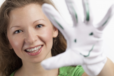 Smiling young woman with smiley glove Stock Photo - 15891984