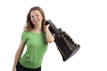 self awareness: Young woman throwing a bag over her shoulder