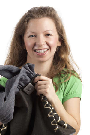 finesse: Laughing young woman touches her bag