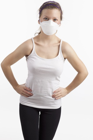 haze: Young woman with dust mask Stock Photo