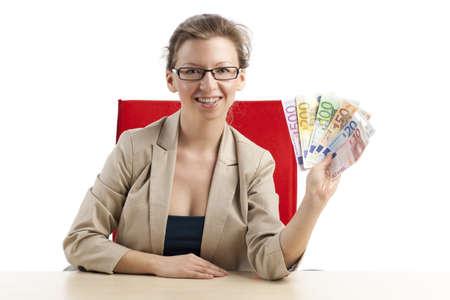 remuneraciones: La mujer muestra fan alegría de billetes de euro Foto de archivo