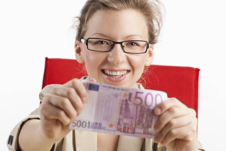 Young woman shows joyfully five hundred euro note photo