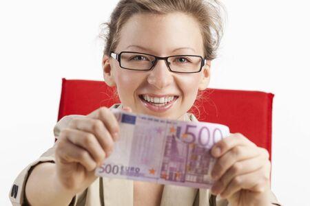 equivalence: Young woman shows joyfully five hundred euro note Stock Photo